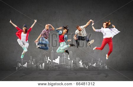 summer, sport, dancing and teenage lifestyle concept - group of teenagers jumping with city drawing in the back