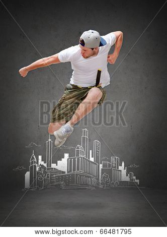 dancing, happiness and people concept - male dancer jumping in the air with city drawing in the back