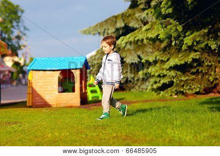 Boy Playing Near Toy House