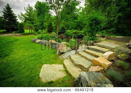 Stone Stairway On A Lush Green Garden Path