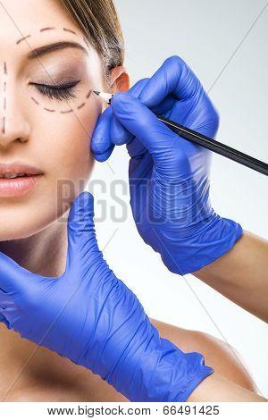 Beautiful woman half face photo plastic surgery plastic surgeon hands