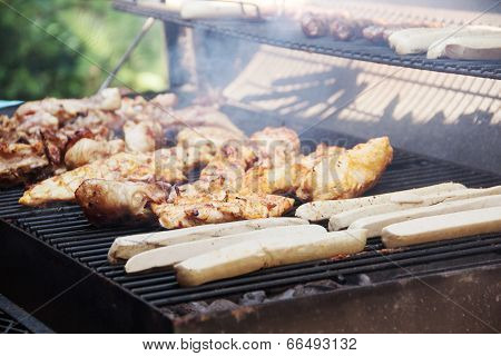 Chicken Meat And Sausages On The Gril