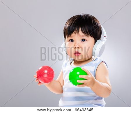 Baby listen to music and play ball