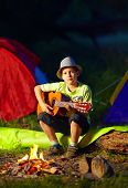 image of bonfire  - boy playing a guitar near bonfire summer camp - JPG