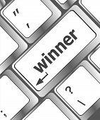 foto of raffle prize  - winner button on the keyboard key close - JPG