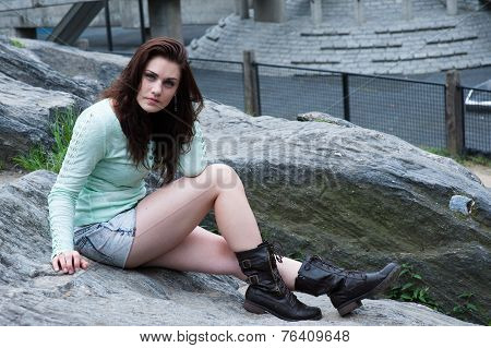 Young Brunette Sitting In The Park