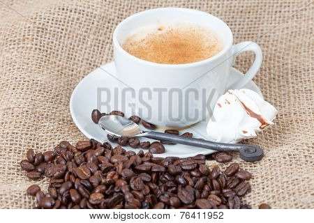 Delicious Freshly Brewed Cup Of Coffee With Whole Beans On Burlap
