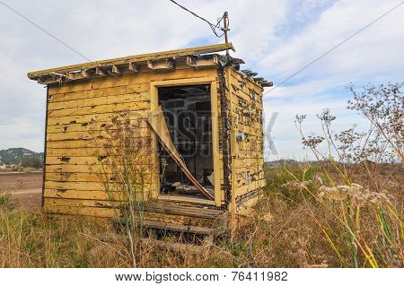 Old Abandoned Wooden Shed In Field