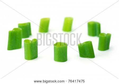 Scallions arranged in a circle,  isolated on white.