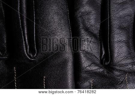 Black leather gloves detail