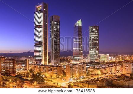 Madrid, Spain financial district skyline at twilight.