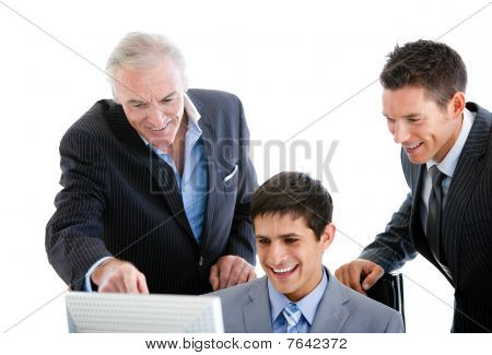 Self-assured Businessmen Working At A Computer