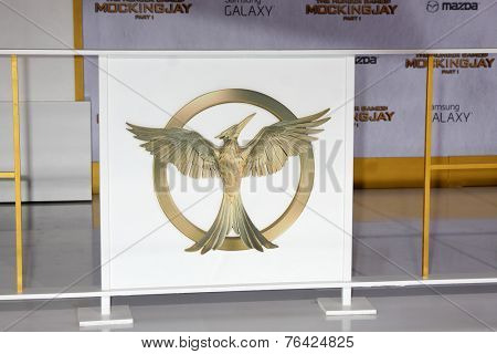 m LOS ANGELES - NOV 17:  Mockingjay Emblem at the The Hunger Games: Mockingjay Part 1 Premiere at the Nokia Theater on November 17, 2014 in Los Angeles, CA