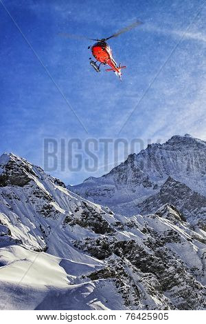Red Helicopter At Swiss Alps Sky Near Jungfrau Mountain