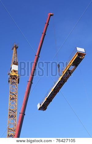 Assembling Tower Crane Using A Mobile Crane.