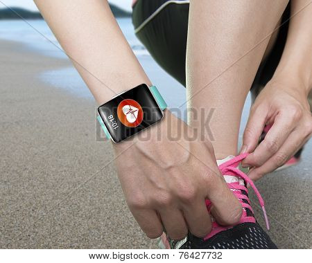 Female Hand Tying Shoelaces Wearing Bright Green Watchband Touchscreen Smartwatch