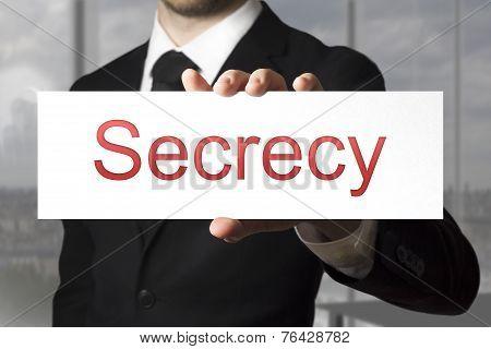 Businessman Holding Sign Secrecy
