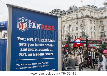 LONDON, UK - SEPTEMBER 27: NFL billboard with London underground entrance in Regent Street. September 27, 2014 in London. The street was closed to traffic to host NFL related games and events.
