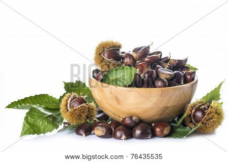 Chestnuts In A Wooden Bowl Isolated On A White Background