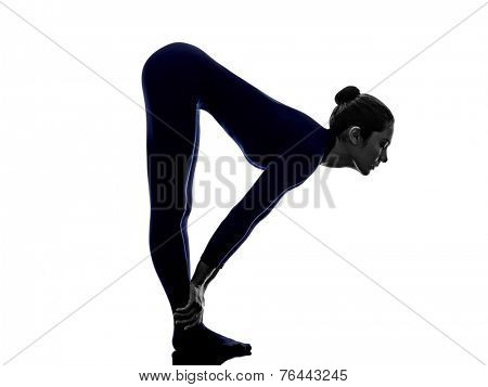 woman exercising Ardha Uttanasana standing half forward bend pose yoga silhouette shadow white background