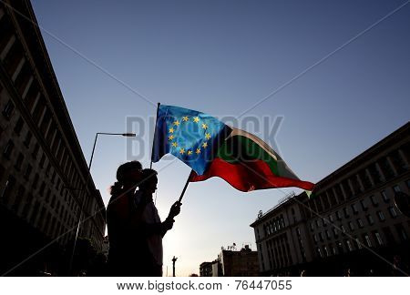 Silhuette Of People Holding Bulgarian And Eu Flags