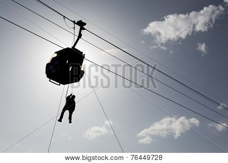 Cabin Ski Lift Silhouette And Rescuer