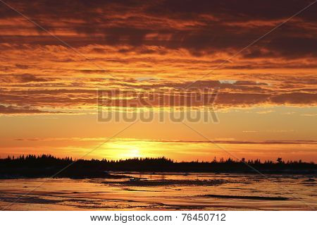 Blazing Sunset over the frozen Frasier River in Hudson Bay Canada