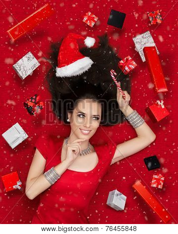Happy Christmas Girl Holding Candy Cane surrounded by Presents