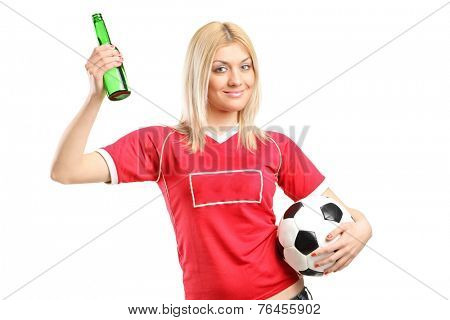 Young female fan holding a beer bottle and football isolated on white background