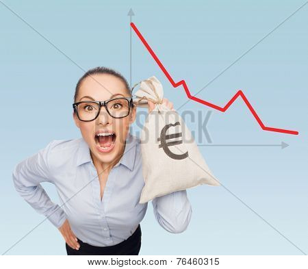 business, money and people concept - businesswoman in eyeglasses holding money bag with euro over blue background and graph