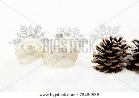 Many Silver Christmas Baubles,pine Cones,snowflakes On Snow
