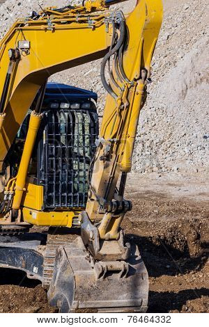 excavator on a construction site. excavator bucket with soil, earth works.