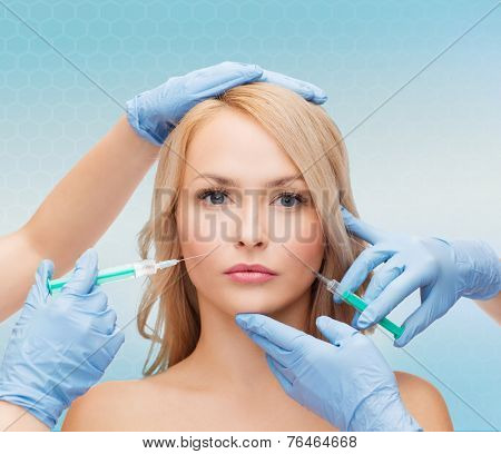 beauty, people and plastic surgery concept - woman face and beautician hands with syringes