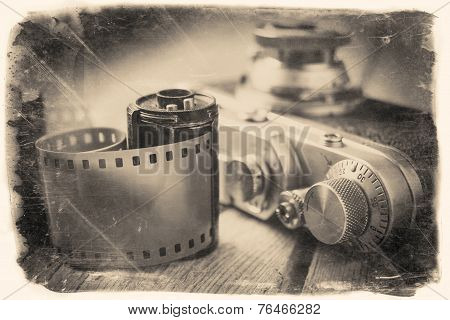 Old Photo Film Roll And Retro Camera