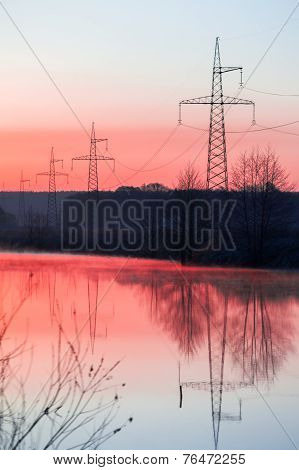 Landscape With Power Line On Sunset.