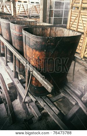 Old Wooden Wheelbarrow With Vats
