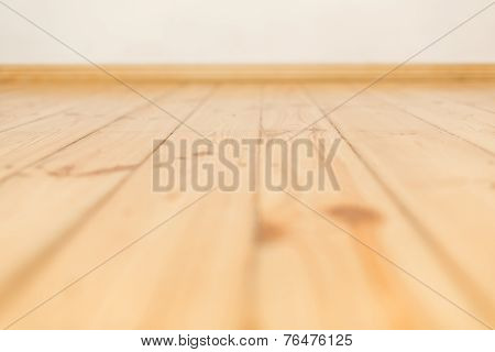 Warm wooden floor made of planks side by side