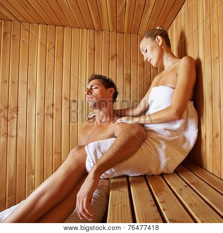 Man and woman relaxing together in the sauna of an hotel