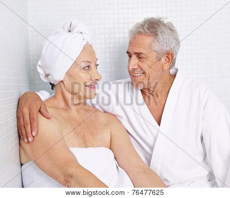 Senior couple sitting for relaxation in a spa in their holidays