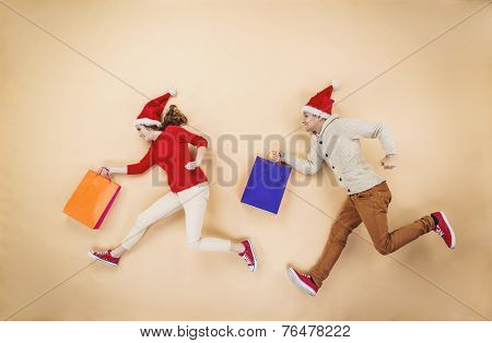 Christmas couple with shopping bags