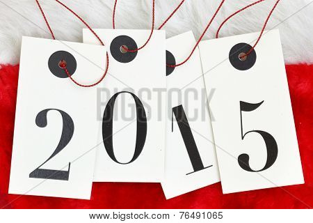 New year 2015 on tags on santas fur