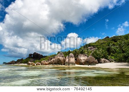 Captivating Lagoon with Big Rocks, Green Trees and High Hill on the Water Side. Located at Seychelles Island.