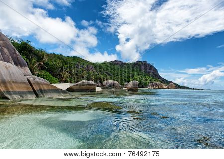 Beautiful Natural View of Anse Source d'Argent with Rocks and Mountains on the Beach Side at La Digue. A Tourist Destination in Seychelles.
