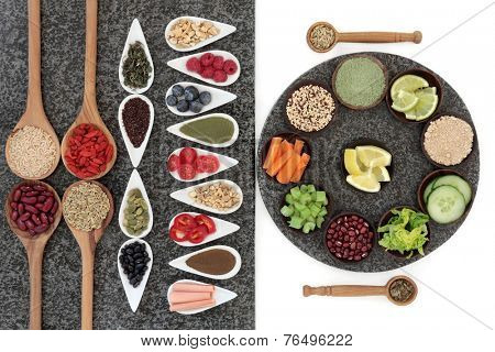 Large diet and weight loss super food selection in bowls and spoons on marble over white background.