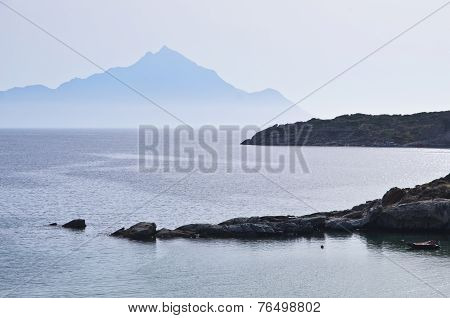 Greek coast of aegean sea at sunrise near holy mountain Athos