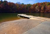 stock photo of dock a lake  - Concrete boat ramp and small dock on Badin Lake North Carolina - JPG