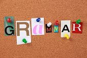 foto of grammar  - The word Grammar in cut out magazine letters pinned to a corkboard - JPG