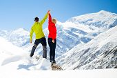 image of couple  - Couple hikers man and woman success in winter mountains sport climbing - JPG