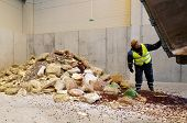image of sedimentation  - Sofia Bulgaria - January 28 2014: Workers are storing chopped sweets near an organic waste plant near Sofia.