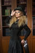 stock photo of gothic girl  - Vintage sexy girl next to the bookcase - JPG